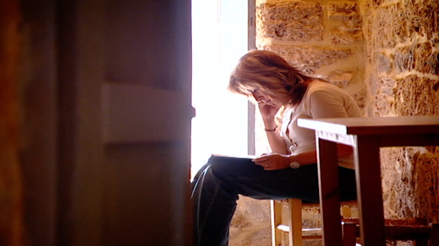 stockvideo's en b-roll-footage met view of a religious pilgrim sitting in contemplation in one of the cells in our lady of our lady of qannoubine monastery. she is on a religous... - pelgrim