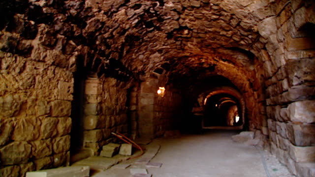 view of a religious pilgrim walking towards one of the cells in our lady of our lady of qannoubine monastery. she is on a religous retreat. the... - pilgrim stock videos & royalty-free footage