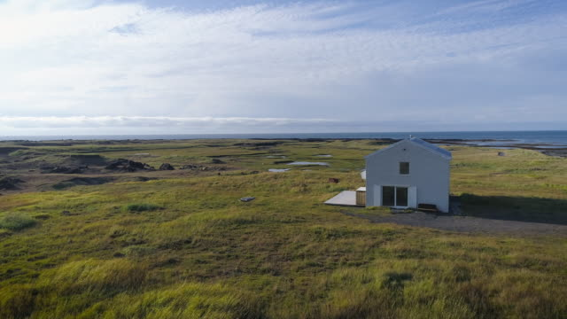 view of a remote house on the west coast in iceland - remote location bildbanksvideor och videomaterial från bakom kulisserna