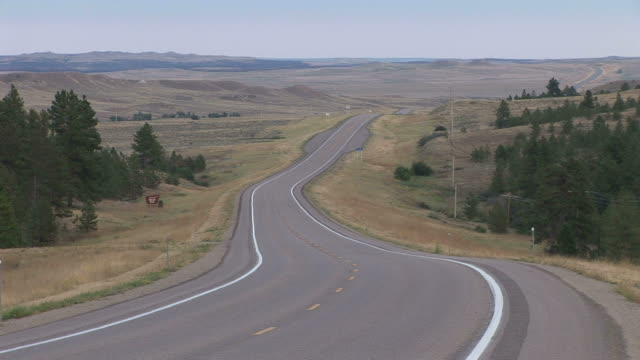 view of a road in montana united states - eternity stock videos & royalty-free footage