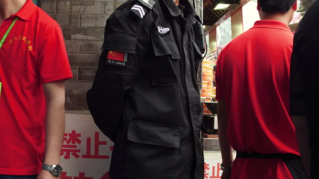 A view of a security guard at famous Wangfujing shopping street on May 4 2017 in Beijing China Wangfujing Street is a famous shopping street which...