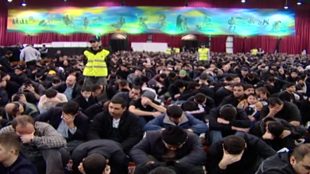 view of a security guard watching over a crowd of mourning men during the ashura commemoration organised by hezbollah in dahieh - karbala stock videos & royalty-free footage