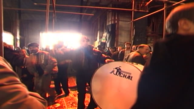 view of a shia man banging a drum while a procession performes azadari rituals during ashura in a mosque in isfahan province ashura the tenth day of... - karbala stock videos & royalty-free footage