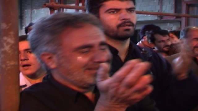 view of a shia man thumping his chest and crying during ashura in a mosque in isfahan province ashura the tenth day of the islamic month of muharram... - ashura muharram stock videos & royalty-free footage