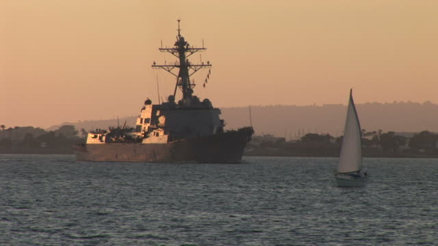 View of a ship cruising at magic hour in San Diego United States