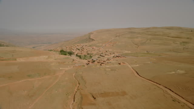 vidéos et rushes de view of a small village and terrace fields in the mountainous region of north morocco, africa - maroc