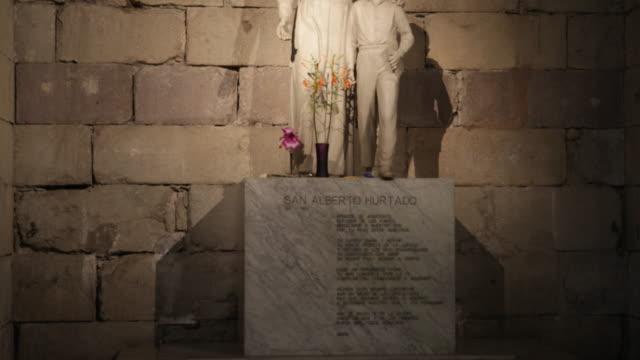 view of a statue of san alberto hurtado inside the metropolitan cathedral in santiago de chile father alberto hurtado was a famous jesuit saint... - christian ender stock-videos und b-roll-filmmaterial