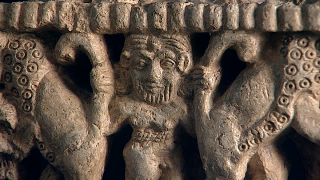 view of a stone carving of the hero king gilgamesh wresting two lions by gripping their tails early third millennium bce sumerian sculpture hall... - carving craft product stock videos & royalty-free footage