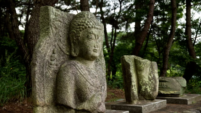 view of a stone seated buddha in gyeongju - north gyeongsang province stock videos and b-roll footage