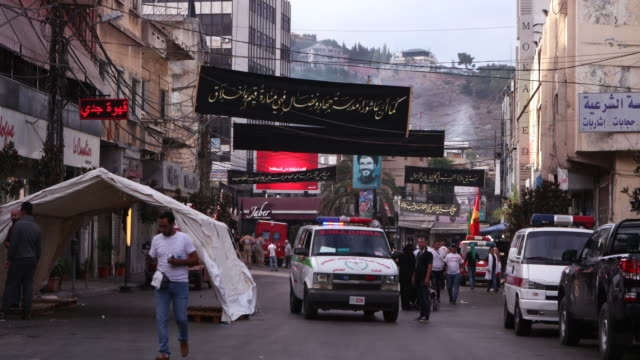 view of a street in nabatieh decorated with black ashura banners ashura is the 10th day of muharram commemorating the martyrdom of hussain ibn ali... - ashura muharram stock videos & royalty-free footage