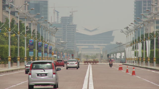 view of a street in putrajaya, malaysia - putrajaya stock videos & royalty-free footage