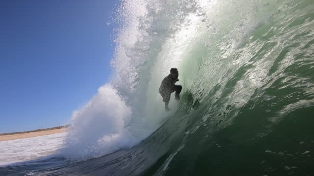 pov view of a surfer getting tubed while surfing waves on his surfboard. - slow motion - サーフィン点の映像素材/bロール
