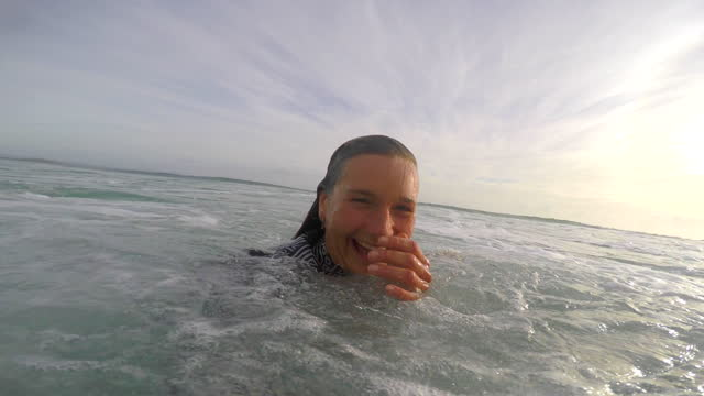 pov view of a surfer surfing waves on his surfboard. - time-lapse - leisure activity stock videos & royalty-free footage