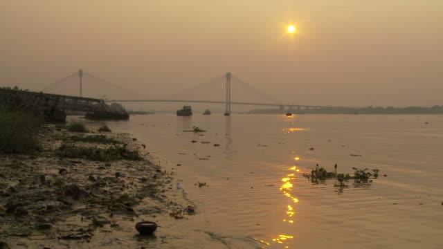 view of a suspended cable bridge in kolkata, india - kolkata stock videos & royalty-free footage
