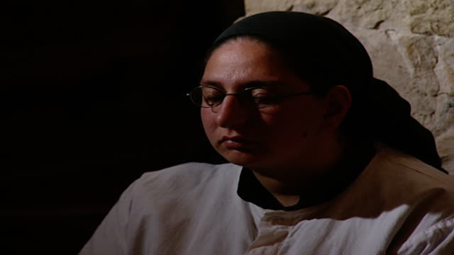 mcu view of a syrian syriac catholic nun sitting in religious contemplation in the monastery church - eyes closed stock videos & royalty-free footage
