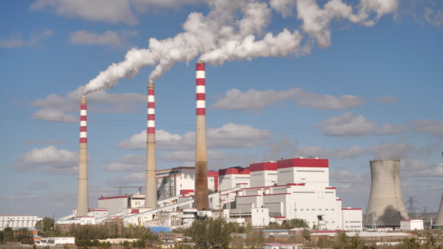 a view of a thermal power plant - smoke stack stock videos & royalty-free footage