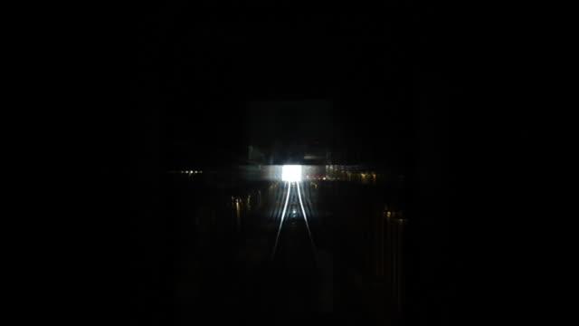 A view of a train going through a train tunnel.