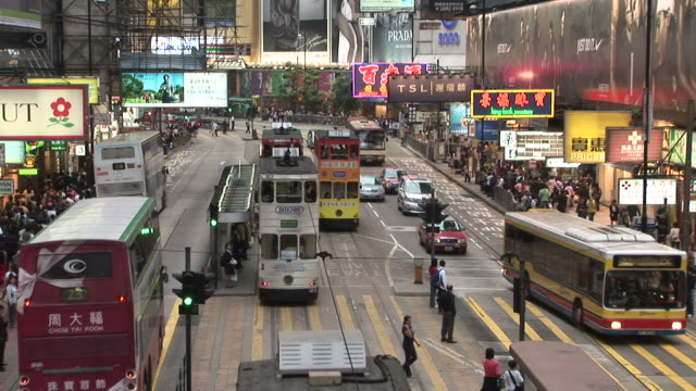 view of a tram stop in hong kong china - zebramuster stock-videos und b-roll-filmmaterial