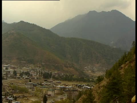a view of a valley in thimphu bhutan - thimphu stock videos & royalty-free footage