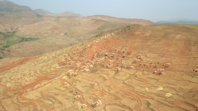 vidéos et rushes de view of a village and terrace fields in the mountainous region of north morocco, africa - maroc