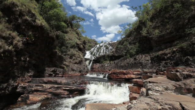 view of a waterfall at brazilian 'cerrado' - couros - cerrado stock videos & royalty-free footage