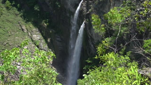 view of a waterfall at brazilian 'cerrado' - tilt cam - cerrado stock videos & royalty-free footage