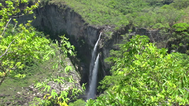 view of a waterfall at brazilian 'cerrado' - wide angle view - cerrado stock videos & royalty-free footage