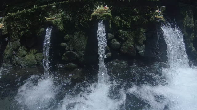 pov view of a waterfall in exotic tropical bali, indonesia. - ubud district stock videos & royalty-free footage