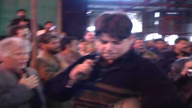 view of a young man selfflagellating during ashura in a mosque in isfahan province ashura the tenth day of the islamic month of muharram commemorates... - ashura muharram stock videos & royalty-free footage