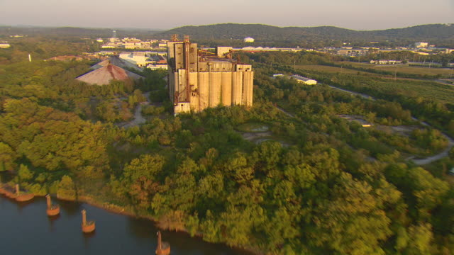 ws aerial view of abandoned grain storage facility on tennessee river / chattanooga, tennessee, united states - chattanooga stock videos and b-roll footage