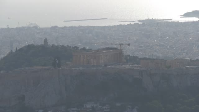 view of acropolis from mount lycabettus, athens, greece, europe - lycabettus hill stock videos & royalty-free footage