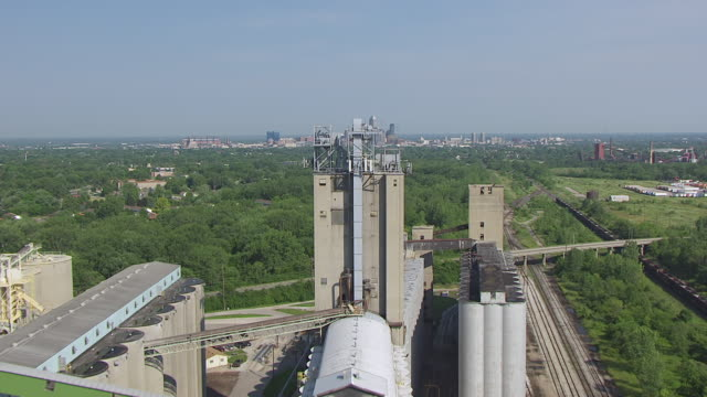 WS AERIAL POV View of ADM Grain mill with downtown Indy in background / Indianapolis, Marion County, Indiana, United States