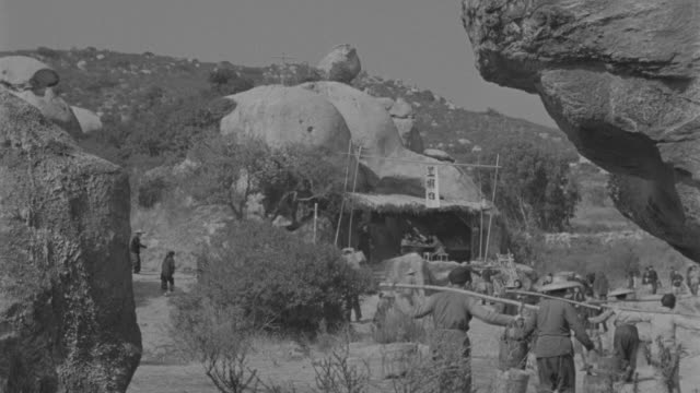 ws  view of administration dwelling in moutain area and some people fetching water - gold rush stock videos and b-roll footage