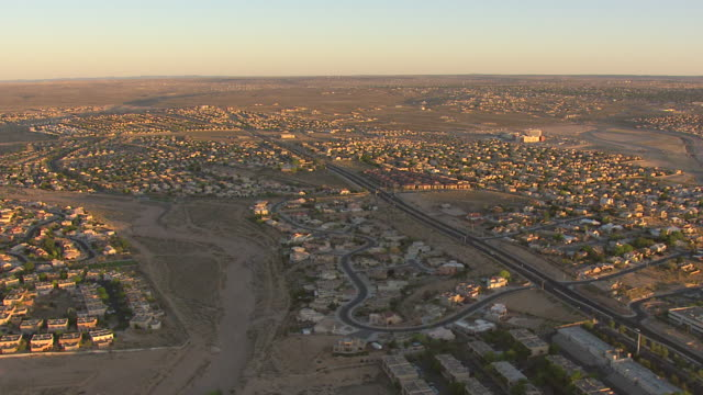 ws aerial view of adobe houses in morning sun / albuquerque, new mexico, united states - adobe stock videos & royalty-free footage