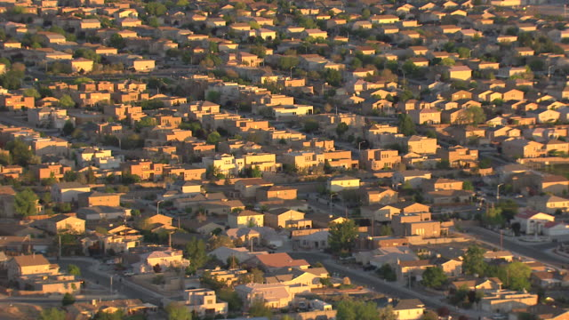 ms aerial view of adobe houses in morning sun / albuquerque, new mexico, united states - adobe stock videos & royalty-free footage