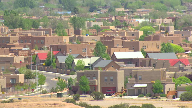 WS AERIAL View of adobe style houses in Santa Fe County / New Mexico, United States