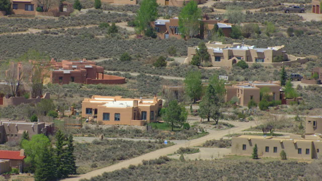 MS AERIAL View of adobe style houses in Taos County / New Mexico, United States