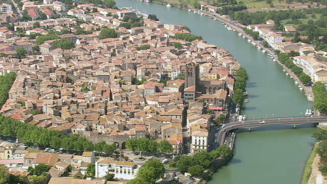 ws aerial zi zo view of agde city with river / languedoc roussillon, france - heranzoomen stock-videos und b-roll-filmmaterial