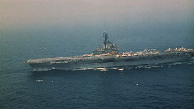 ms aerial view of aircraft carrier  - flugzeugträger stock-videos und b-roll-filmmaterial