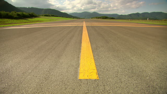 ws pan view of airfield runway leading upto mountains / fukashima, tohoku, japan - campo d'aviazione video stock e b–roll