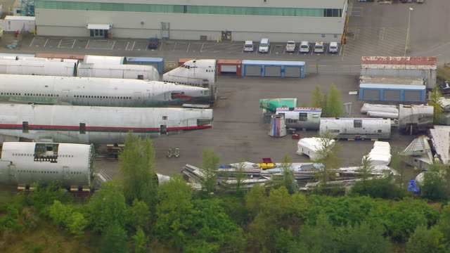 WS AERIAL ZI View of airplane fuselages and parts outside of Boeing Everett factory / Everett, Washington, United States