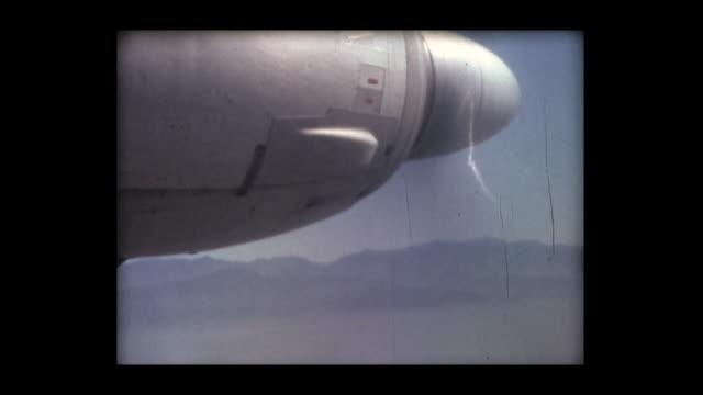 1966 cu view of airplane propellor in flight - プロペラ機点の映像素材/bロール