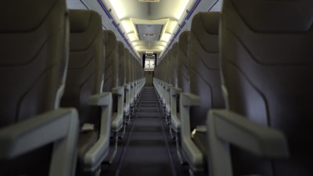 View of airplane seats through aisle