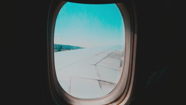 View of Airplane Wings through the Cabin Window