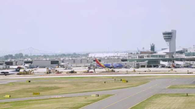 MS AERIAL View of airport with plane taking off / Philadelphia