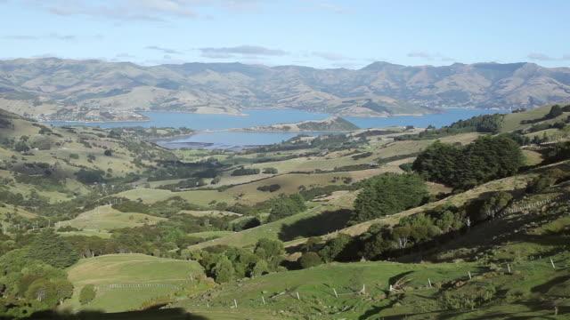 ws view of akaroa river with mountains area / akaroa, new zealand - akaroa stock videos & royalty-free footage