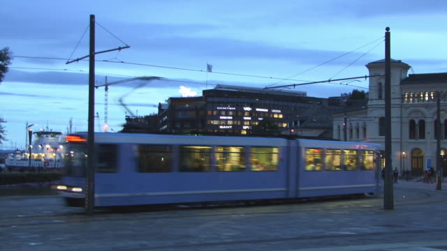 ws, view of aker brygge at dusk, oslo, norway - tram stock videos & royalty-free footage