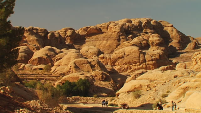 ws view of al khazneh with people / petra, jordan - treasury stock videos and b-roll footage