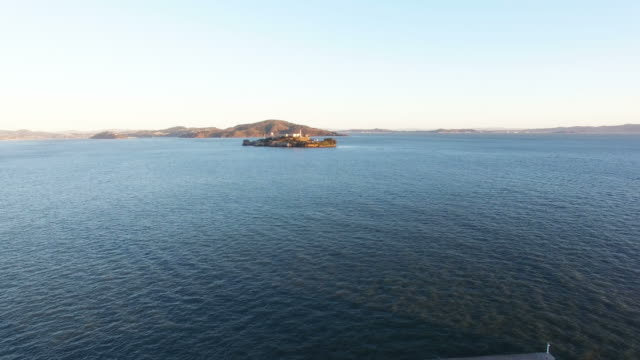view of alcatraz island and breakwater - horizon over land stock videos & royalty-free footage