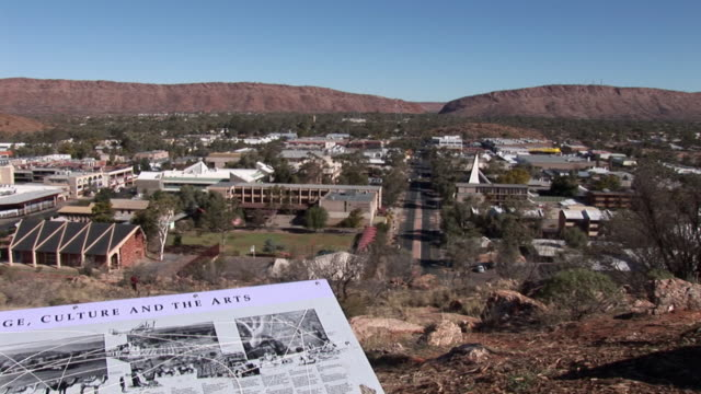 WS PAN View of Alice Springs from Anzac Hill, information board in foreground, Alice Springs, Northern Territory, Australia